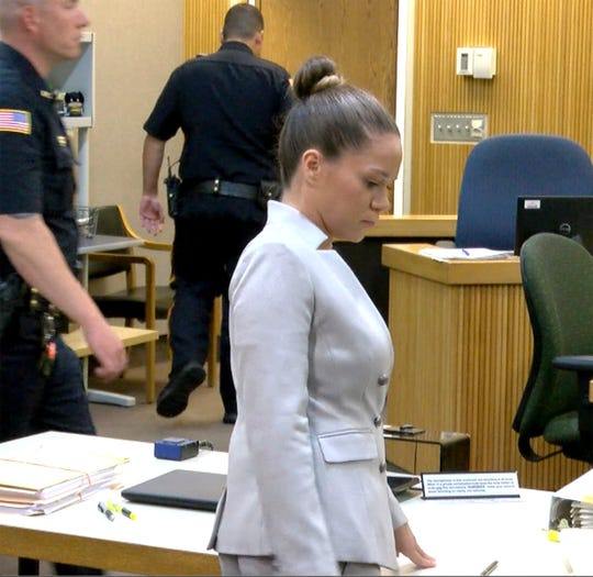 Raquel Garajau is shown at the conclusion of her trial day Tuesday, August 7, 2018, in State Superior Court in Freehold.  She is charged, along with her boyfriend Joseph Villani, with the murder of her pot dealer Trupal Patel.