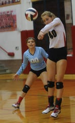 Jim Ned's Tori Million digs an Albany shot while libero Rylan Duncan looks on. Jim Ned beat the Lady Lions 25-20, 25-16, 25-19 in the season-opening match Tuesday, Aug. 7, 2018 at Bill Thornton Arena in Tuscola.