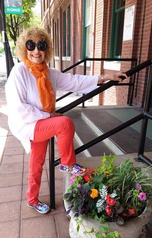 Martha Kiel says a person's fashion is art, so her oversized sunglasses and colorful shows certainly make an artist's statement outside The Grace Museum.