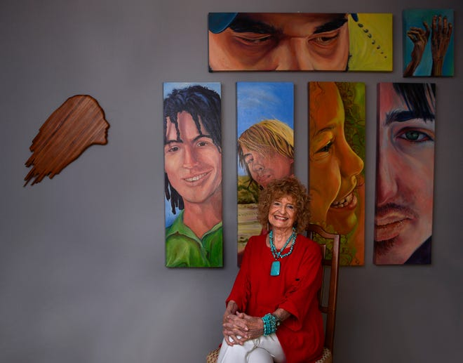 Martha Kiel with portraits of her grandchildren in her Abilene home. Kiel is being honored by The Grace Museum.