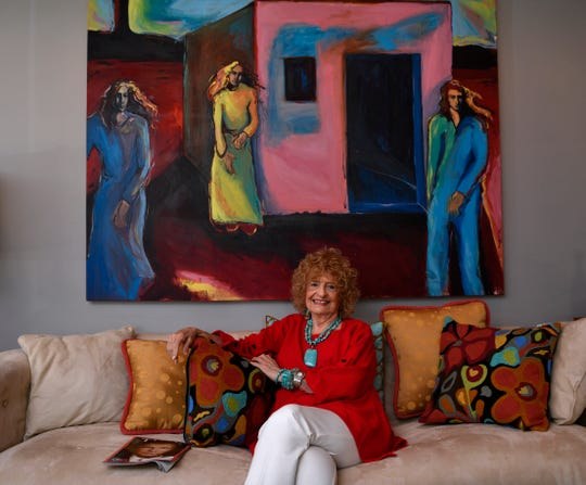 Martha Kiel in her Abilene home Aug. 4. Behind her is a painting by her daughter, Abilene artist Mary K. Huff.