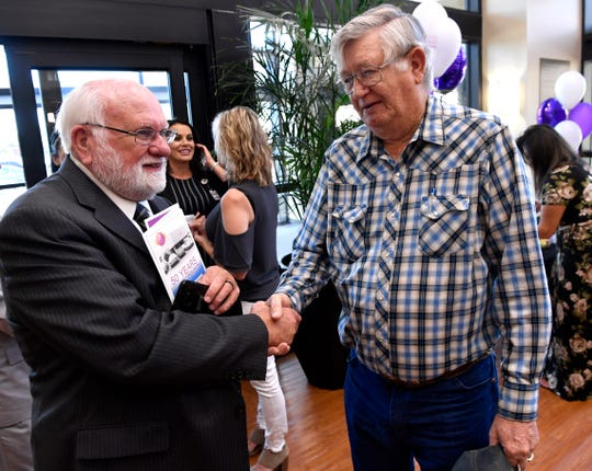 Michael Lee Fink shakes hands Tuesday with Dave Collins during Abilene Regional Medical Center's 50th anniversary celebration. Collins, the former CEO of the hospital, was in the operating room when Fink was the hospital's first open-heart surgery patient in 1970.