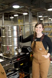 An A-B Tech student stands next to a keg. Students in the Craft Beverage Institute of the Southeast program, who must be 21, do brew beer on site, but they only taste a small portion of it, mainly for quality control and to recognize different inputs.
