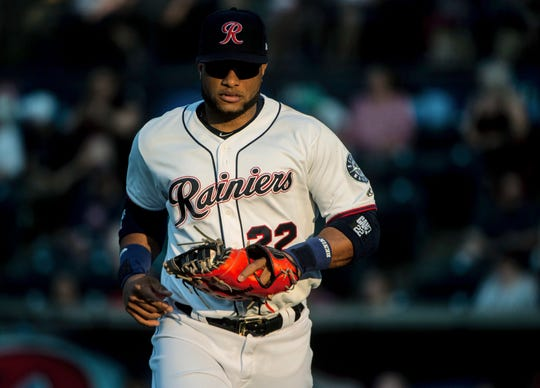 Robinson Cano jogs onto the field during his first rehab start with the Tacoma Rainiers at Cheney Stadium on Monday.