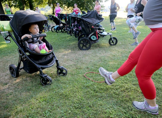 Octavia Van Nostern, 18 months, watches her mom, Katherine, work out in the Fit4Mom Stroller Strides exercises class. Fit4Mom Kitsap holds classes that provide fitness opportunities for new moms and gives them a place where they can connect with fellow moms.
