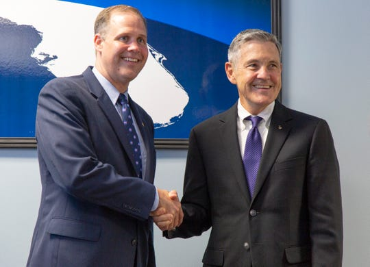 NASA Administrator Jim Bridenstine shakes hands with Kennedy Space Center Director Bob Cabana during his first visit to the Space Coast as agency chief on Tuesday, Aug. 7, 2018.