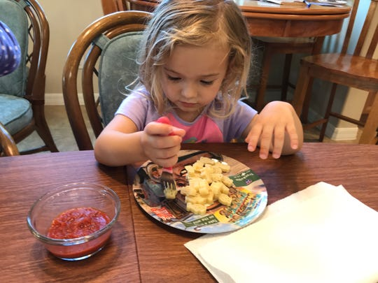"""Isabella eats pasta shaped like Disney's """"Cars"""" characters. She prefers the pasta """"dry,"""" but dips it into sauce on the side."""