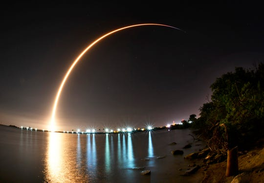 A SpaceX Falcon 9 rocket launches from Cape Canaveral Air Force Station's Launch Complex 40 with the Merah Putih communications satellite on Tuesday, Aug. 7, 2018.