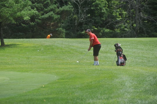 Adam Krebs chips onto the 6th green at Cranberry Hills GC.