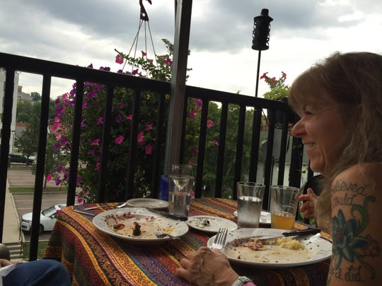 Fabienne Pattison of Montpelier enjoys dinner on the roof at the Istanbul Kebab Shop on lower Church Street on Aug. 2, 2018.