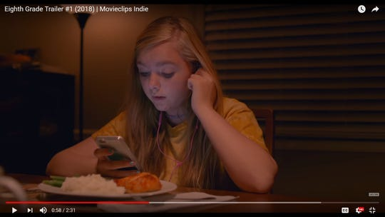 "A screen shot of Elsie Fisher as Kayla Day, a 13-year-old struggling to connect to peers in the final weeks of middle school in the film, ""Eighth Grade."""