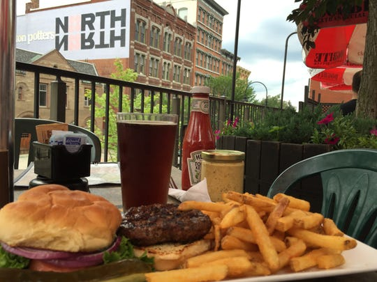 The patio at the Vermont Pub & Brewery has views of College Street (and of its Burly Irish Ale and burger and fries).