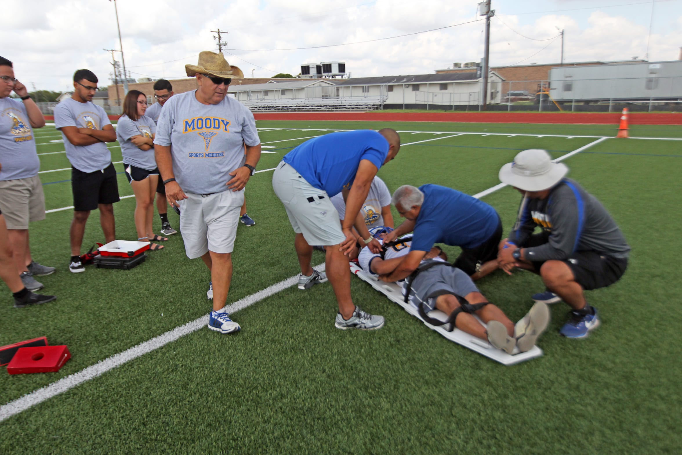Part of the training on how to handle injured players involves making sure the player is not lying on a bed of fire ants. This is not an issue on artificial turf.