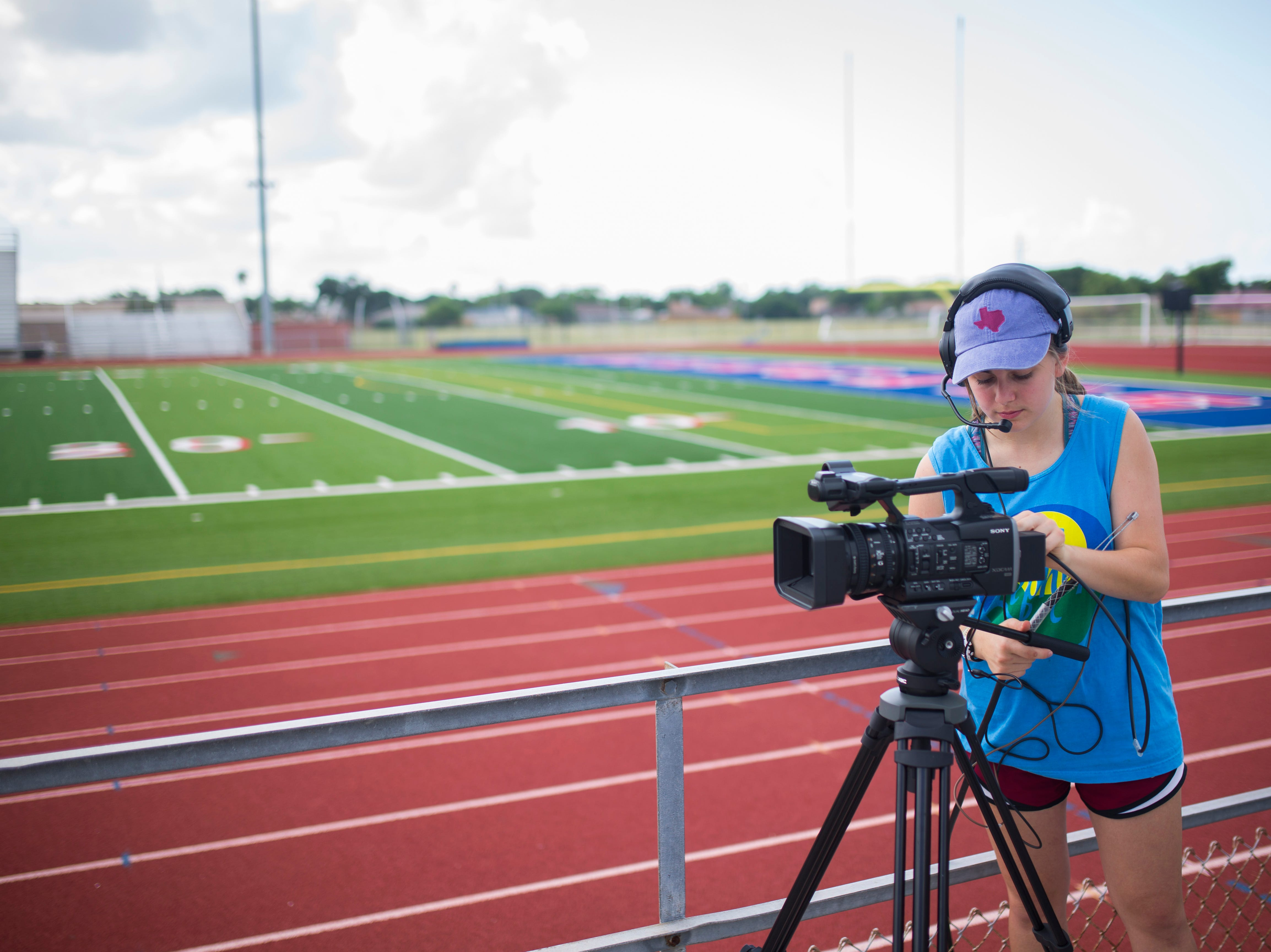 Gregory-Portland Kara DeGaish works with video camera for the upcoming football season, Friday August 3, 2018, at Ray Akins Wildcat Stadium.
