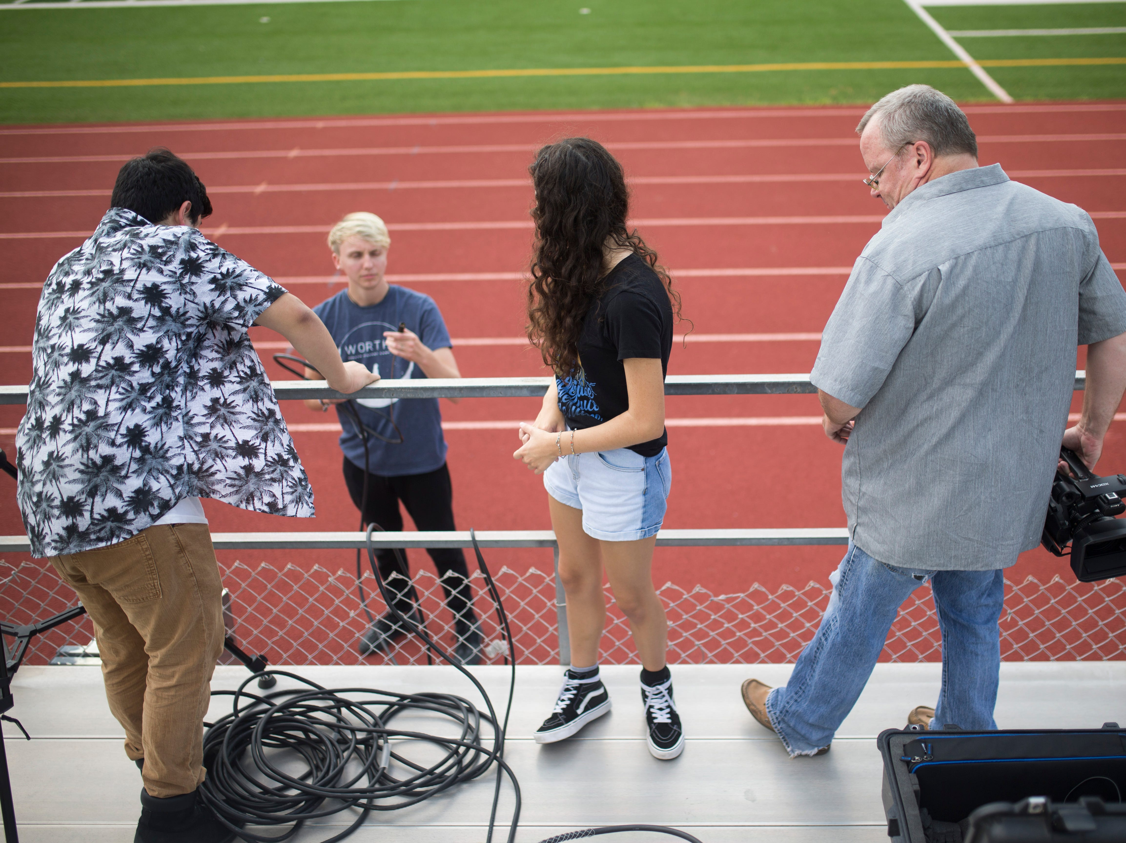 Gregory Portland students practice working with video gear for the upcoming football season, Friday August 3, 2018, at Ray Akins Wildcat Stadium.
