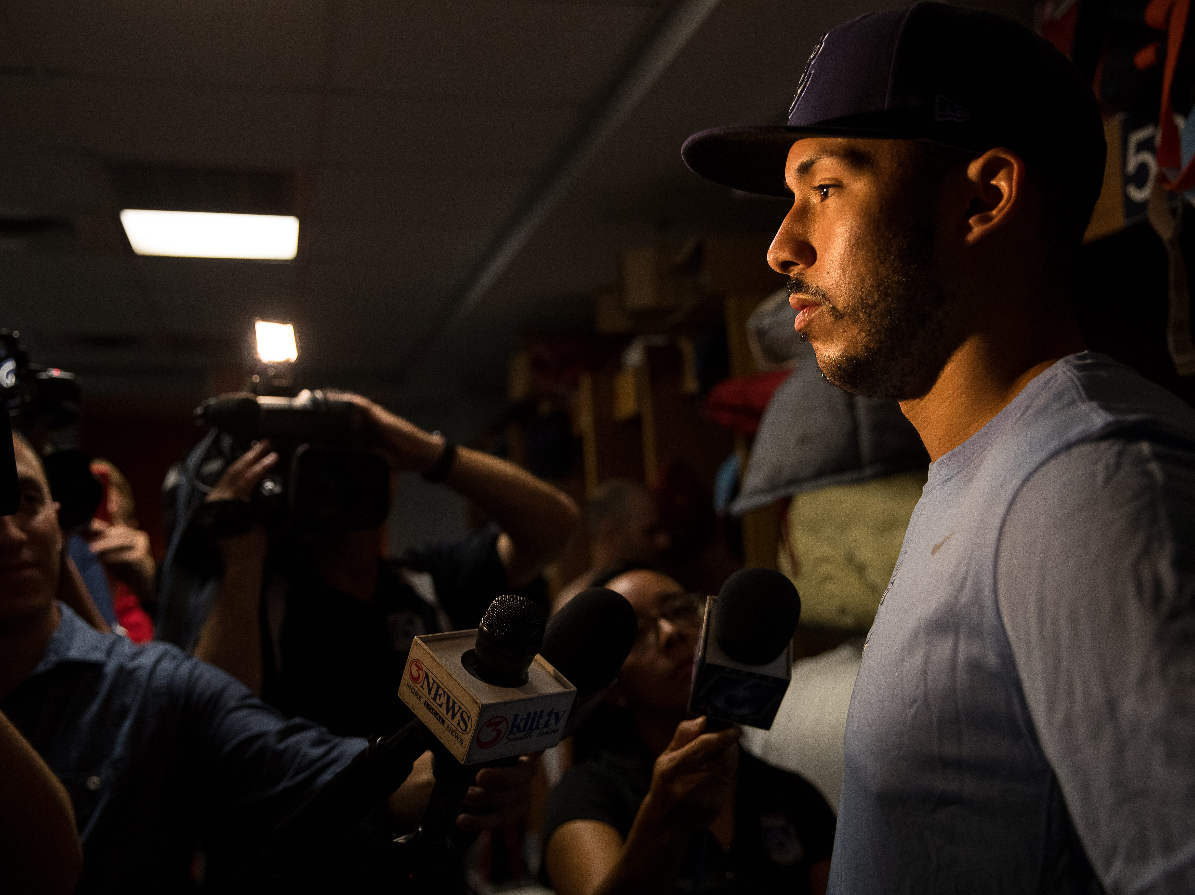 Astros shortstop Carlos Correa talks to the media in the clubhouse at Whataburger Field on Tuesday, Aug. 7, 2018. Correa will be playing shortstop for the Corpus Christi Hooks as he rehabs a back injury.