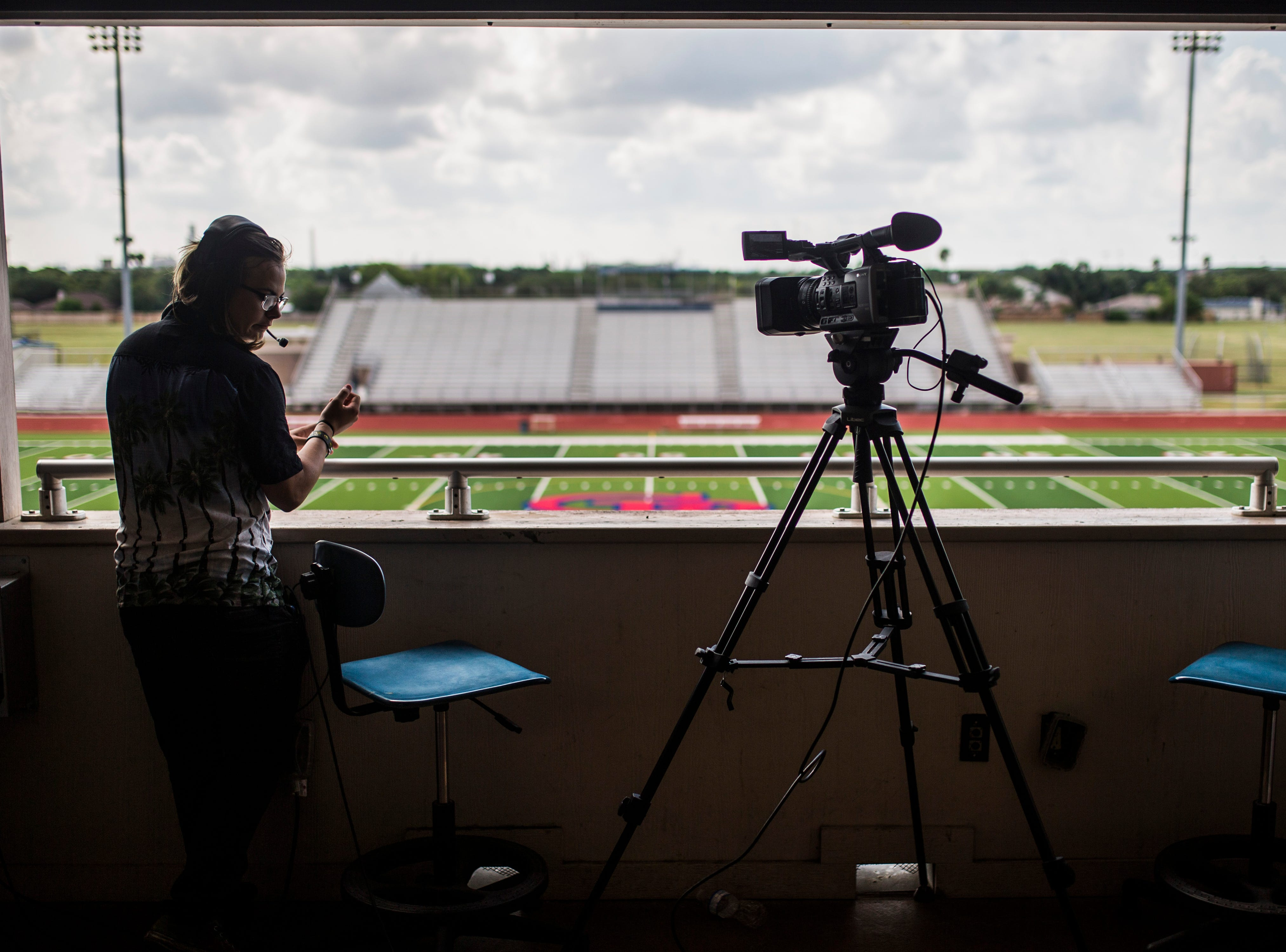 Gregory-Portland's Mike Moody, 16,  works a video camera to practice for the upcoming football season, Friday August 3, 2018, at Ray Akins Wildcat Stadium