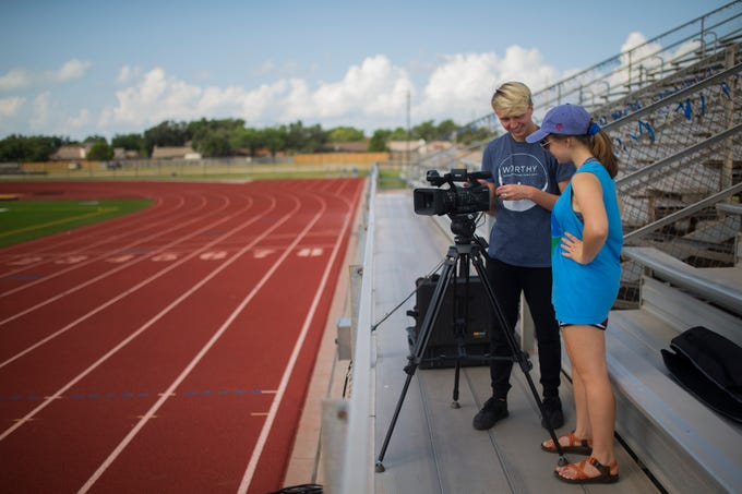 Gregory-Portland students practice working with video gear for the upcoming football season, Friday August 3, 2018, at Ray Akins Wildcat Stadium.