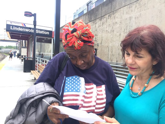Atlantic City Rail Line passengers Maxine Hardy of Lawnside and Patricia a Capilato of Cherry Hill read about NJ Transit's upcoming months-long suspension of the rail line while waiting for the train to the shore