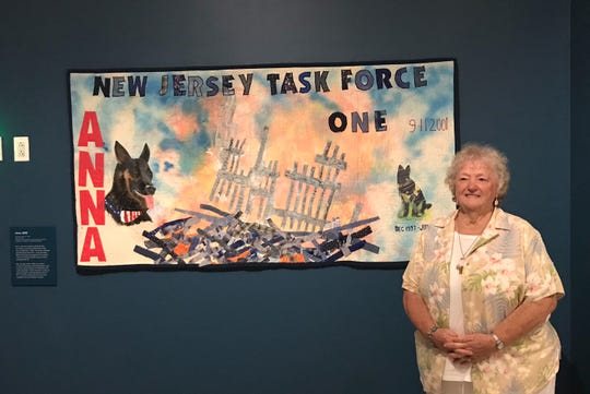 Sue Sanders of Runnemede visits the quilt she created in honor of Anna, a search-and-rescue dog that worked in the rubble of the World Trade Center. The quilt is part of the 'Dogs of 9/11' exhibit at the 9/11 Memorial Museum in New York.