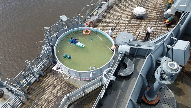 A pool was recently added to the battleship New Jersey deck. Tour-goers can now take a dip just as service men did during the Vietnam era.