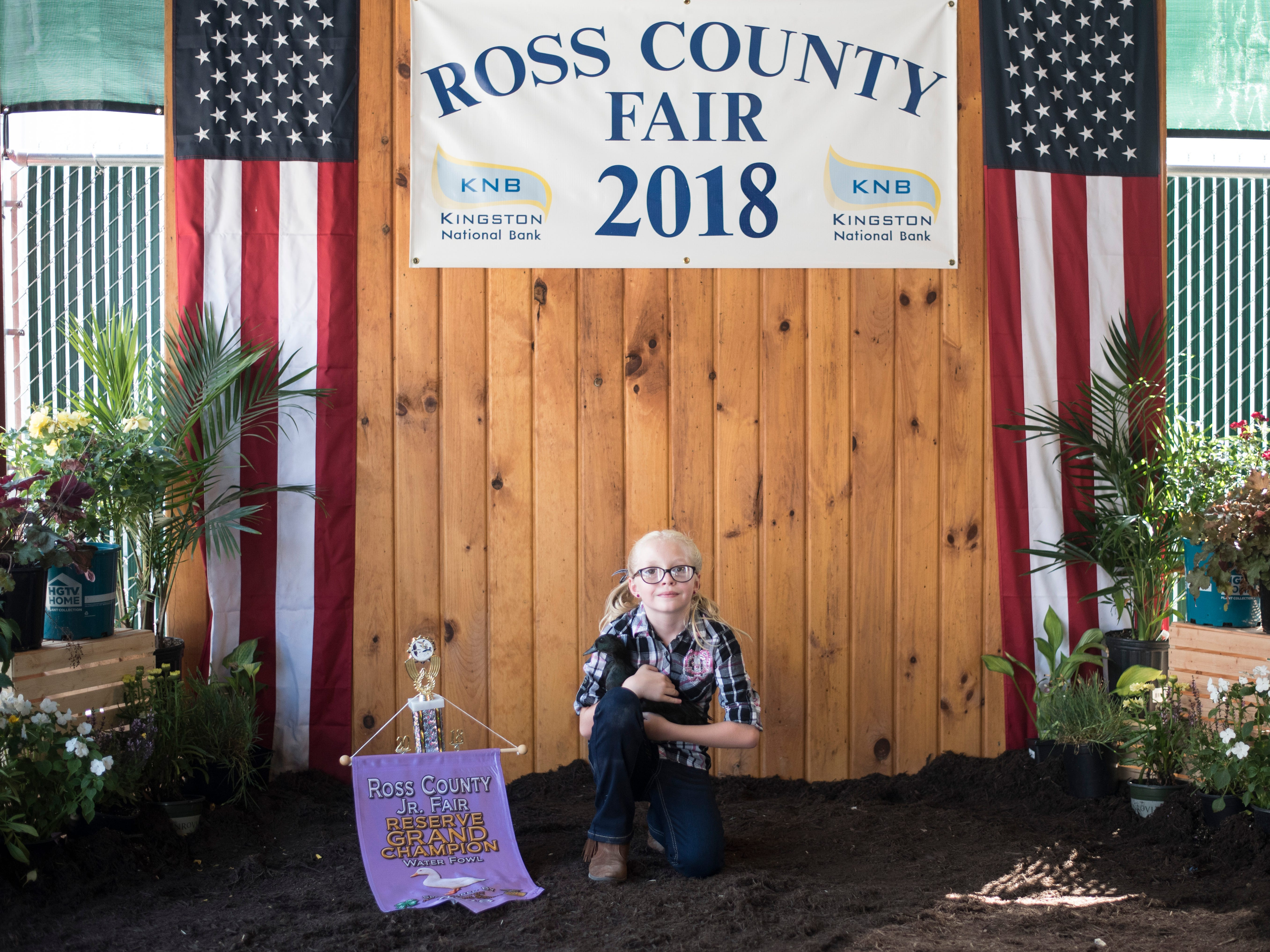 Highlights and portraits of the of the 2018 Jr. Fair Poultry Production and Fancy Poultry judging and showmanship contest. Alayna Benner, 9, poses after winning Reserve Grand Champion with her water fowl at the 2018 Ross County Fair on Monday, August 6.