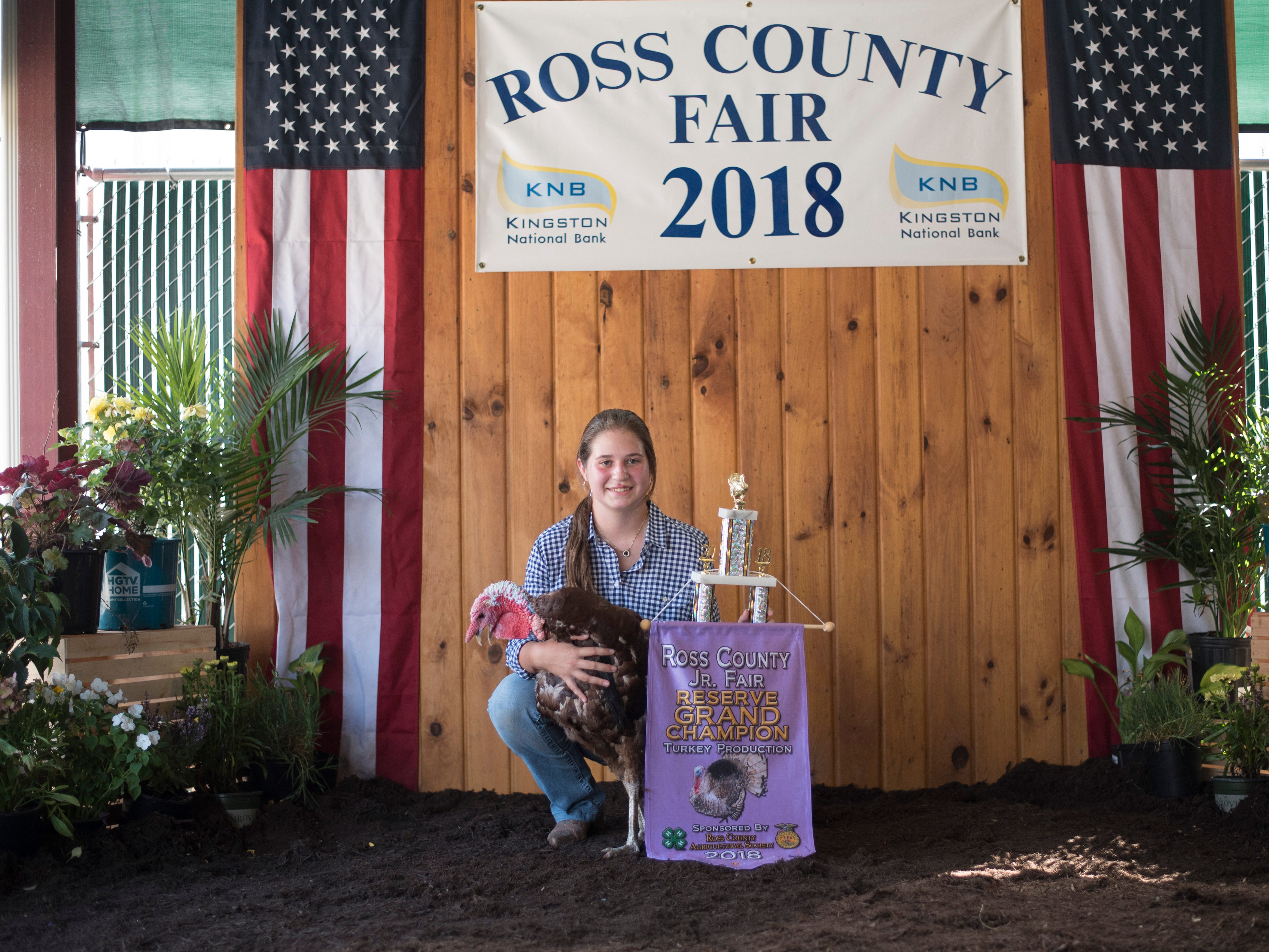 Highlights and portraits of the of the 2018 Jr. Fair Poultry Production and Fancy Poultry judging and showmanship contest. Emily Willis, 17, poses after winning Reserve Grand Champion with her turkey at the 2018 Ross County Fair on Monday, August 6.