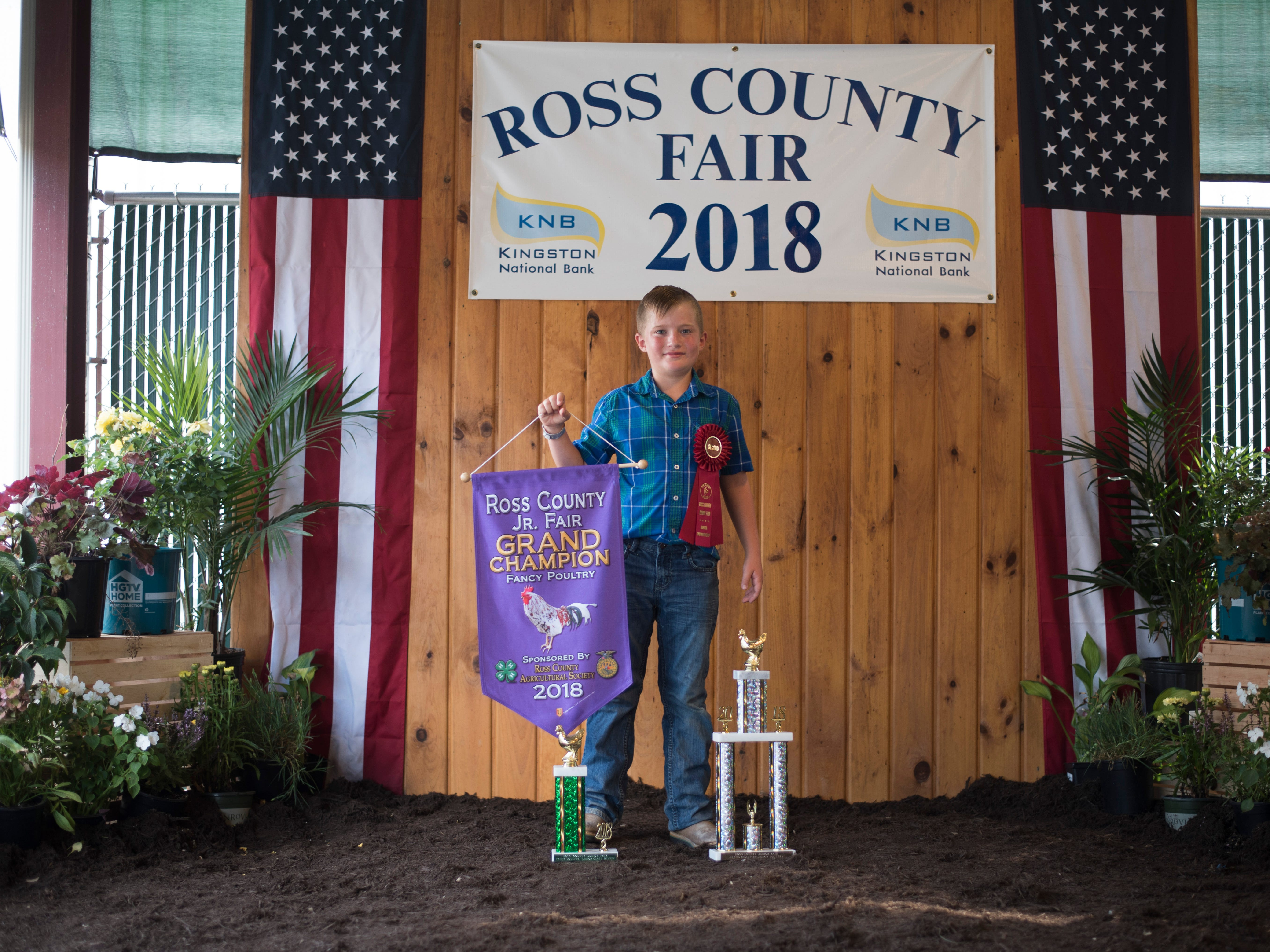 Highlights and portraits of the of the 2018 Jr. Fair Poultry Production and Fancy Poultry judging and showmanship contest. Miles Blackstone, 10, poses after winning Grand Champion for Fancy Poultry at the 2018 Ross County Fair on Monday, August 6.