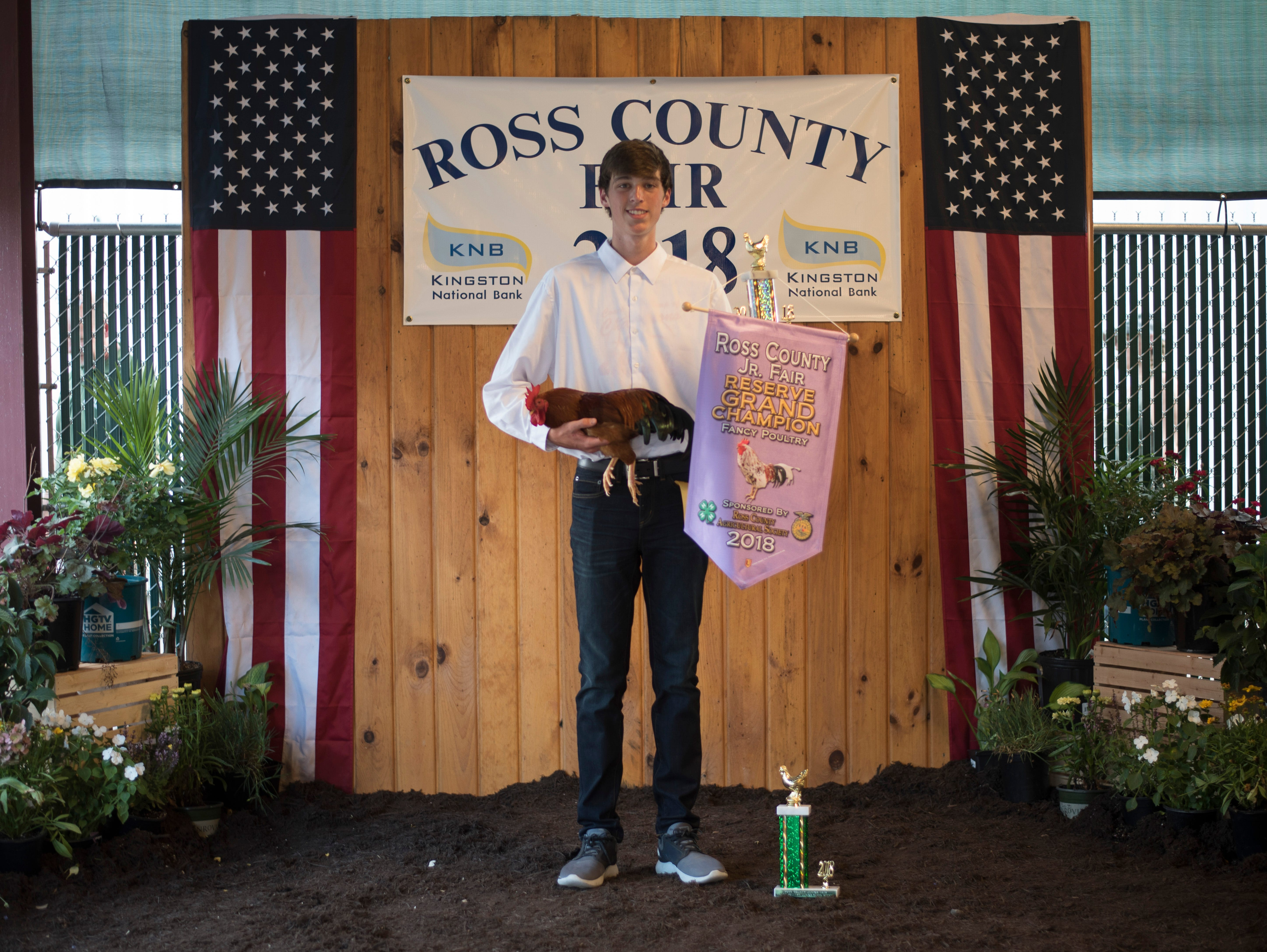 Highlights and portraits of the of the 2018 Jr. Fair Poultry Production and Fancy Poultry judging and showmanship contest. Ethan Nelson, 15, poses after winning Reserve Grand Champion for Fancy Poultry at the 2018 Ross County Fair on Monday, August 6.
