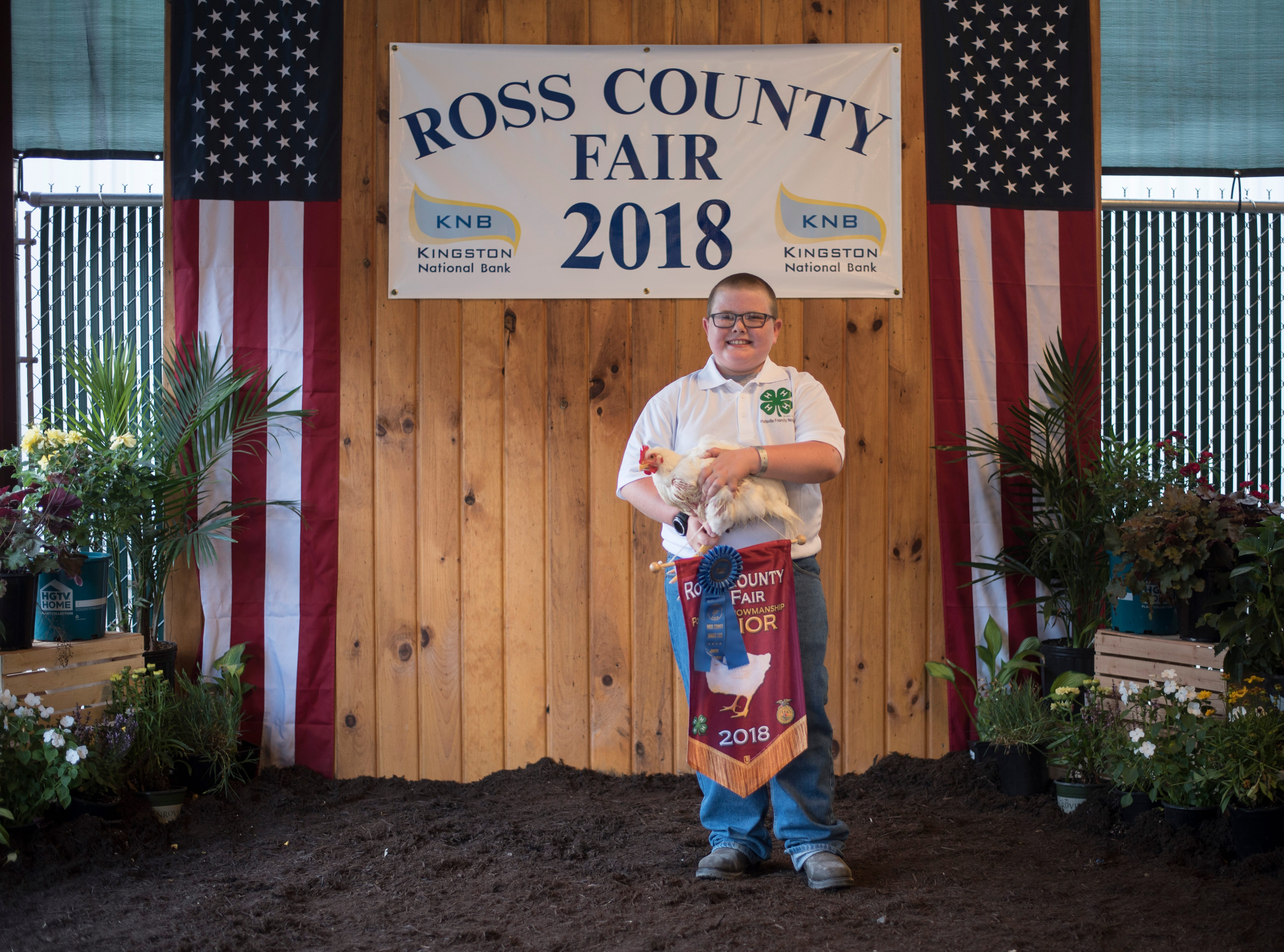 Highlights and portraits of the of the 2018 Jr. Fair Poultry Production and Fancy Poultry judging and showmanship contest. Will Borland, 11, poses after receiving Poultry Showman Junior at the 2018 Ross County Fair on Monday, August 6.