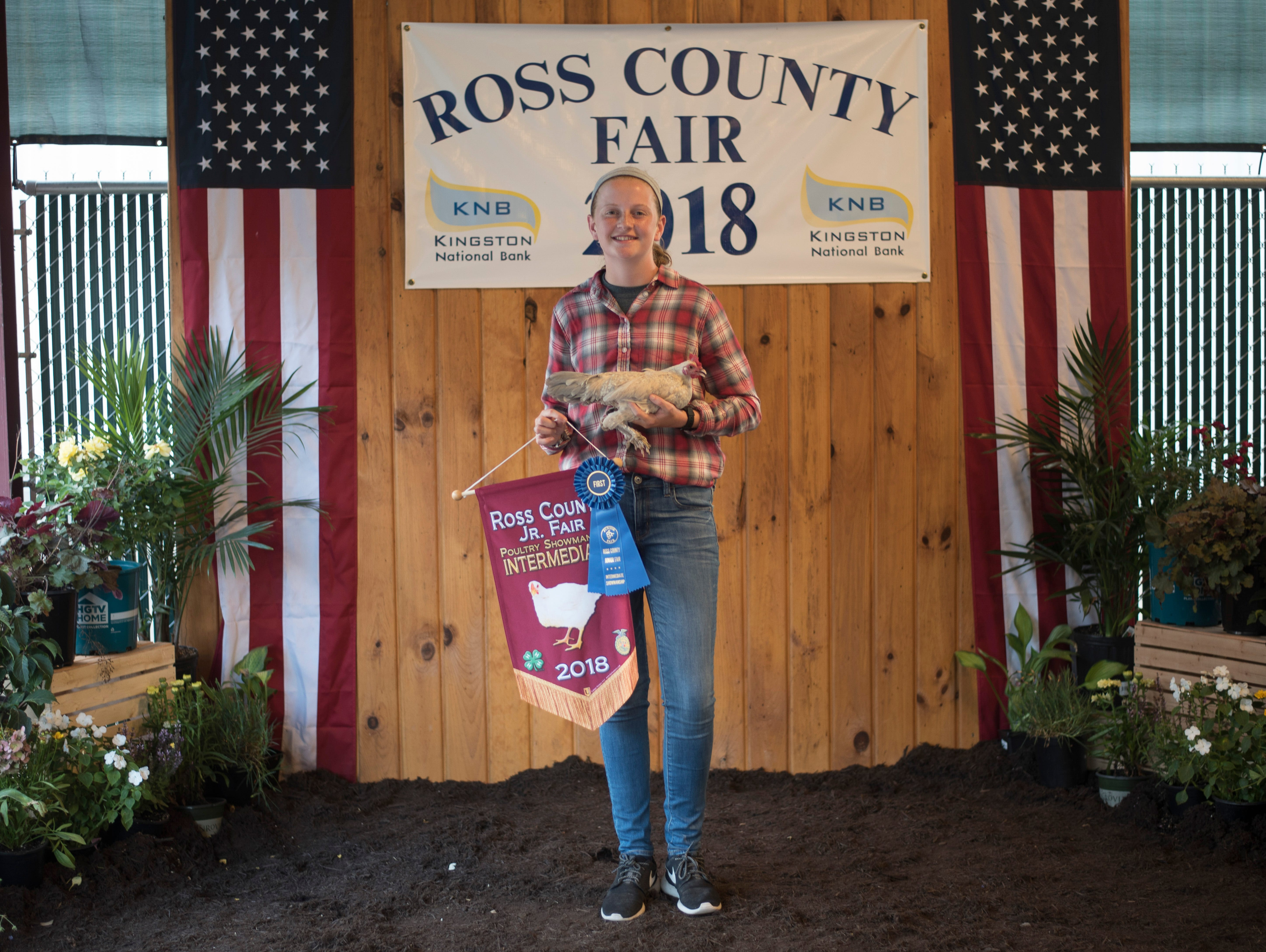 Highlights and portraits of the of the 2018 Jr. Fair Poultry Production and Fancy Poultry judging and showmanship contest. Claire Smith, 15, poses after receiving Poultry Showman Intermediate at the 2018 Ross County Fair on Monday, August 6.