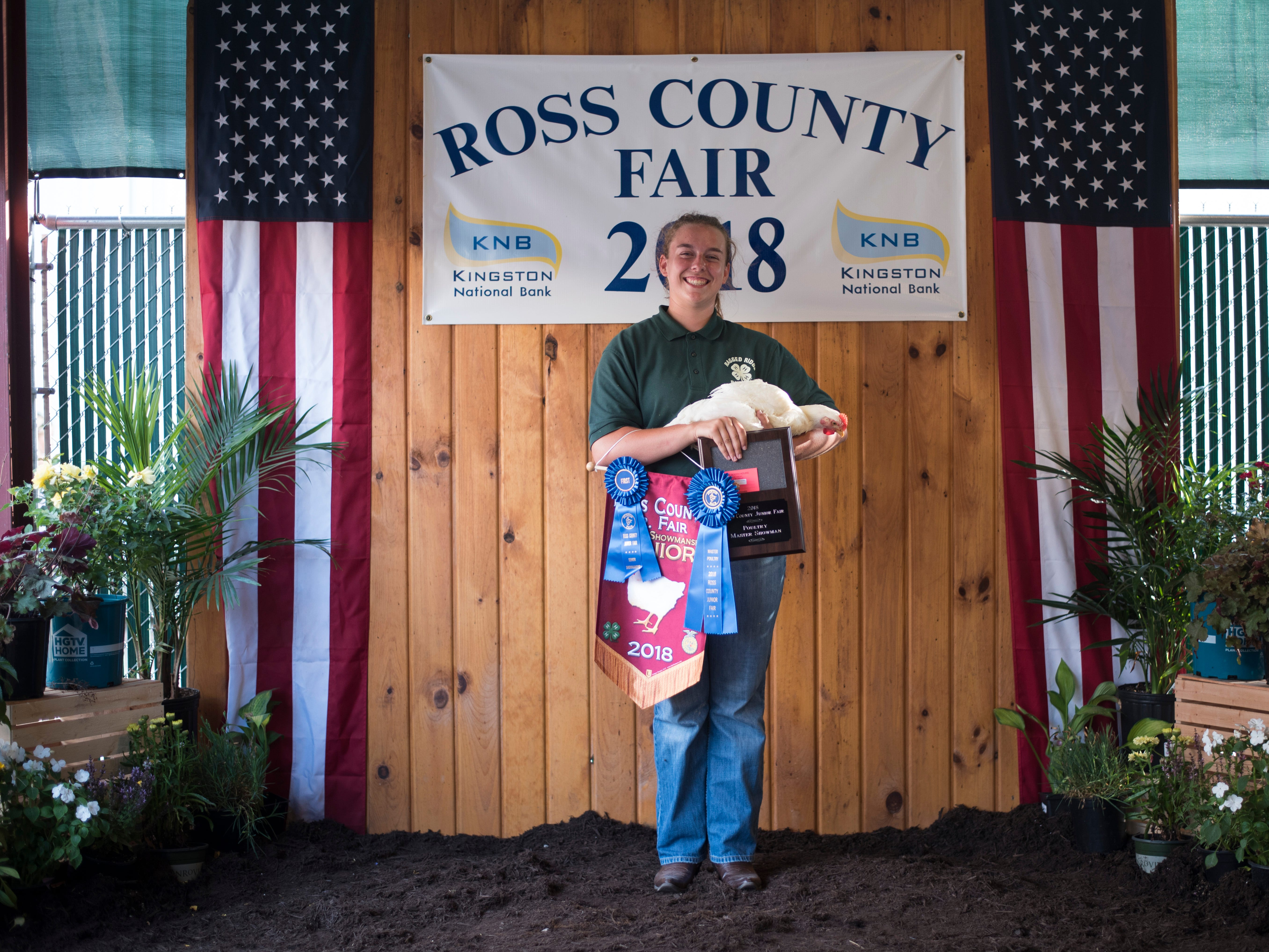 Highlights and portraits of the of the 2018 Jr. Fair Poultry Production and Fancy Poultry judging and showmanship contest. Ruth Beery, 14, poses after receiving Poultry Showman Senior and Poultry Master Showman at the 2018 Ross County Fair on Monday, August 6.
