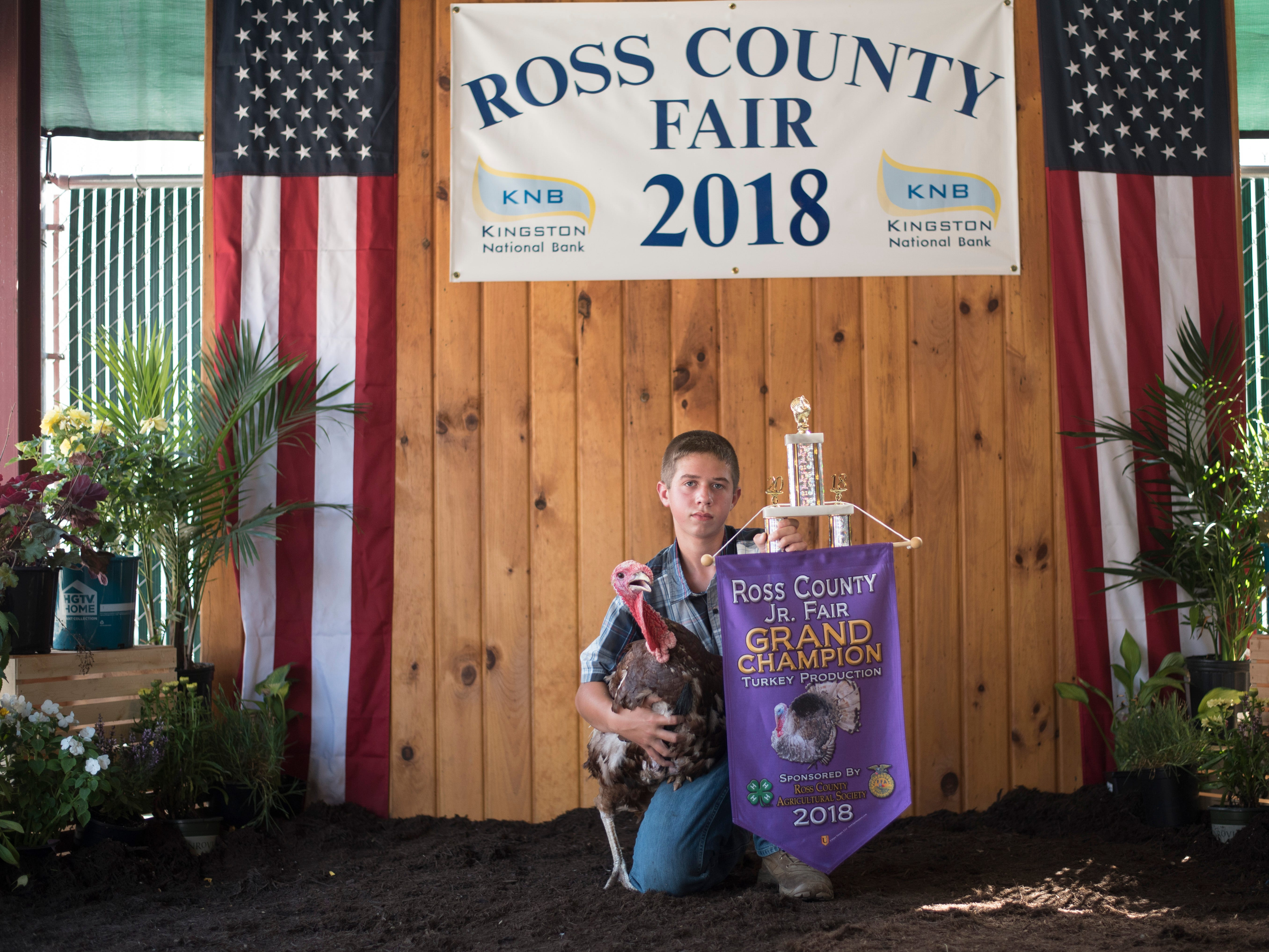 Highlights and portraits of the of the 2018 Jr. Fair Poultry Production and Fancy Poultry judging and showmanship contest. Mason Willis, 14, poses after winning Grand Champion with his turkey at the 2018 Ross County Fair on Monday, August 6.