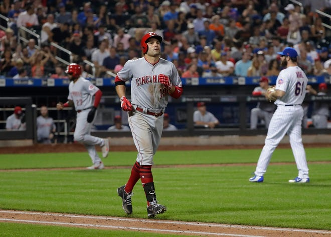Cincinnati Reds' Phillip Ervin (27) heads to home plate after New York Mets relief pitcher Bobby Wahl (61) walked Joey Votto (19) with the bases loaded during the seventh inning of a baseball game Monday, Aug. 6, 2018, in New York.