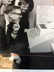 Enquirer sports editor Jim Schottlekotte, foreground, play a game of football in 1970 ... and loses. The computer was built by Cincinnati Milling Machine, the forerunner of today's Milacron.