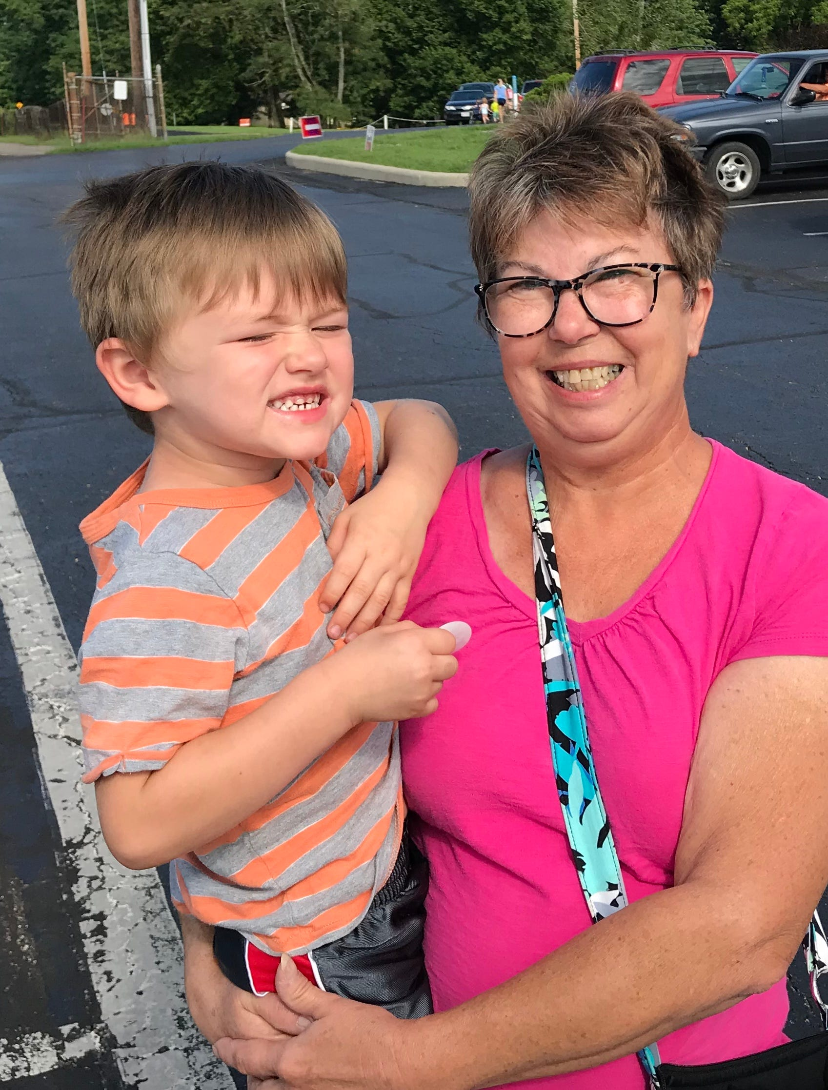 Patricia Hughes, with her grandson, after voting in Newark,. Ohio on Aug. 7 2018.