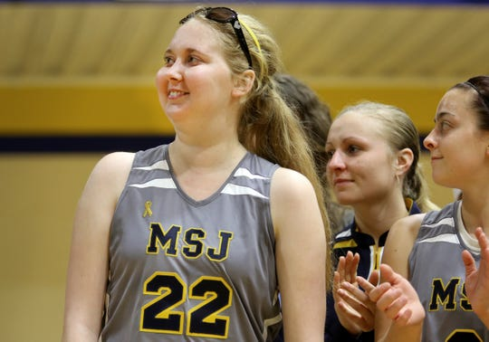 Saturday, Dec. 13, 2014 Lauren Hill, a freshman on the Mount St. Joseph women's basketball team, reacts to the applause, as she is honored following the team's opening game at Harrington Center. Even though the team lost to Franklin College, 68-56, anytime Hill can be part of the team, it's a celebration. Hill has been battling DIPG, a form of brain cancer for the past year. She is terminal. She has become the poster girl for The Cure Starts Now Foundation and has helped raise thousands of dollars for research. Hill shot one layup at the beginning of the game.