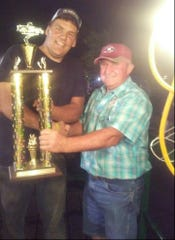 Marc Wirasnik receives his first-place trophy from Bernie Beatty, chief announcer for the truck and tractor pulls at the 2017 Hunterdon County 4-H and Agricultural Fair.