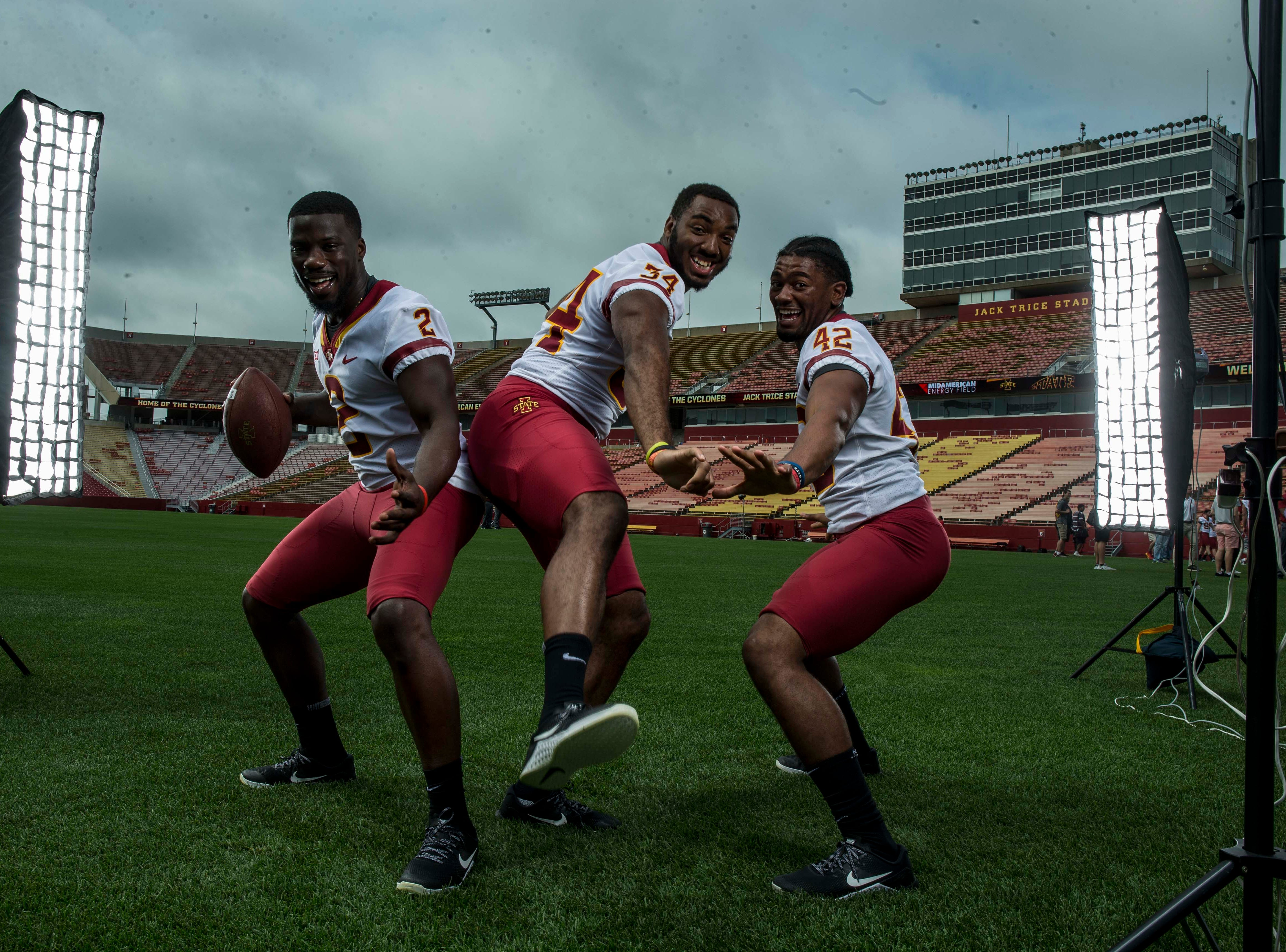 Willie Harvey senior linebacker, (2), O'Rien Vance freshman linebacker, (34), and Marcel Spears Jr. junior linebacker, (42), during Iowa State University's football media day Tuesday, Aug. 7, 2018,, in Ames, Iowa.