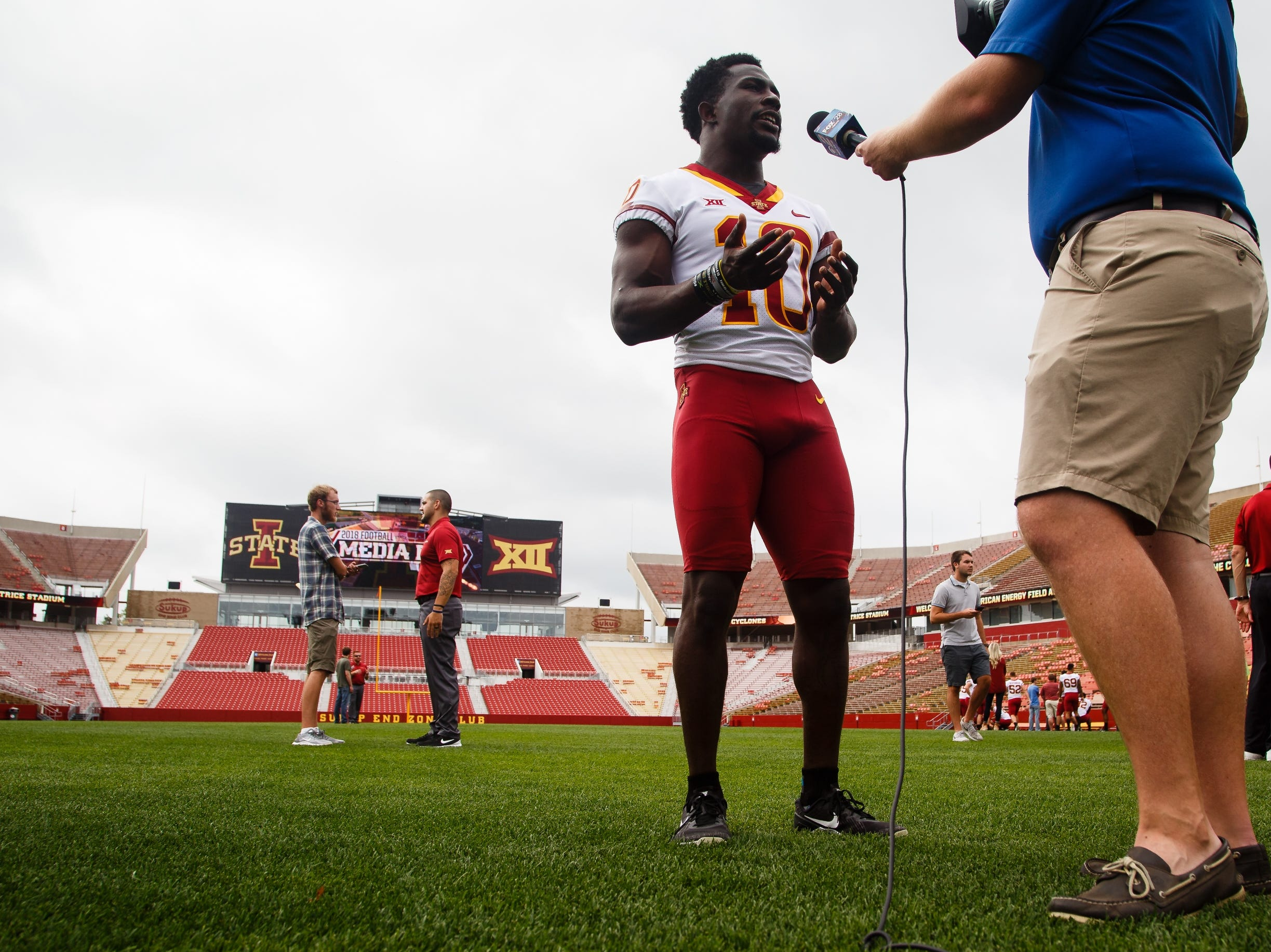 Iowa State's Brian Peavy talks to a reporter during football media day on Tuesday, Aug. 7, 2018 in Ames.