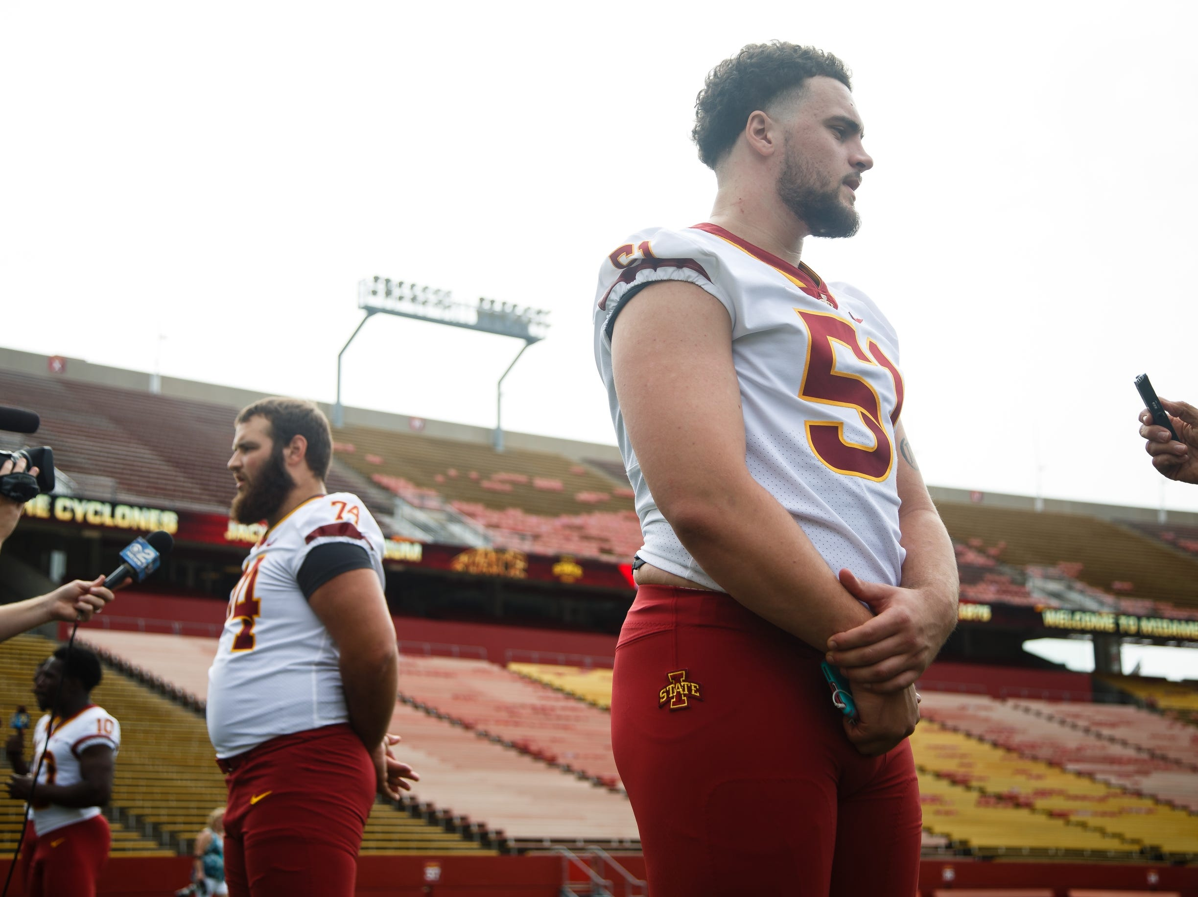 Julian Good-Jones, right, talks to reporters during media day on Tuesday, Aug. 7, 2018 in Ames.