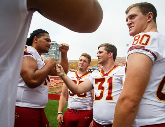 Iowa State football players from left, Kamilo Tongamoa, Tucker Robertson, Conner Greene and Vince Horras, far right, joke around during media day on Tuesday, Aug. 7, 2018 in Ames.