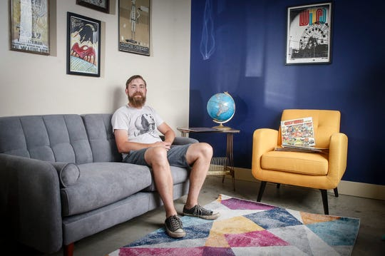 Luke Dickens, a music lover from Des Moines, poses for a photo in the listening room of Vinyl Cup, a new record store on Beaver Avenue that Dickens will open soon.