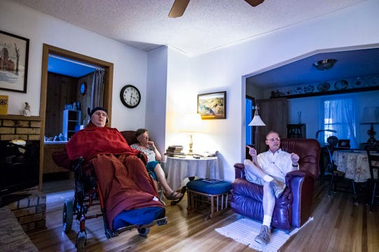 David and Mary Jo Hudson take care of their disabled son Matthew, 30, at their home in Windsor Heights last month.