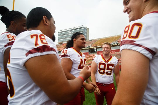 Iowa State football players, Eyioma Uwazurike, far left, Ray Lima, Kamilo Tongamoa, Tucker Robertson, and Vince Horras, far right, joke around during media day on Tuesday, Aug. 7, 2018 in Ames.