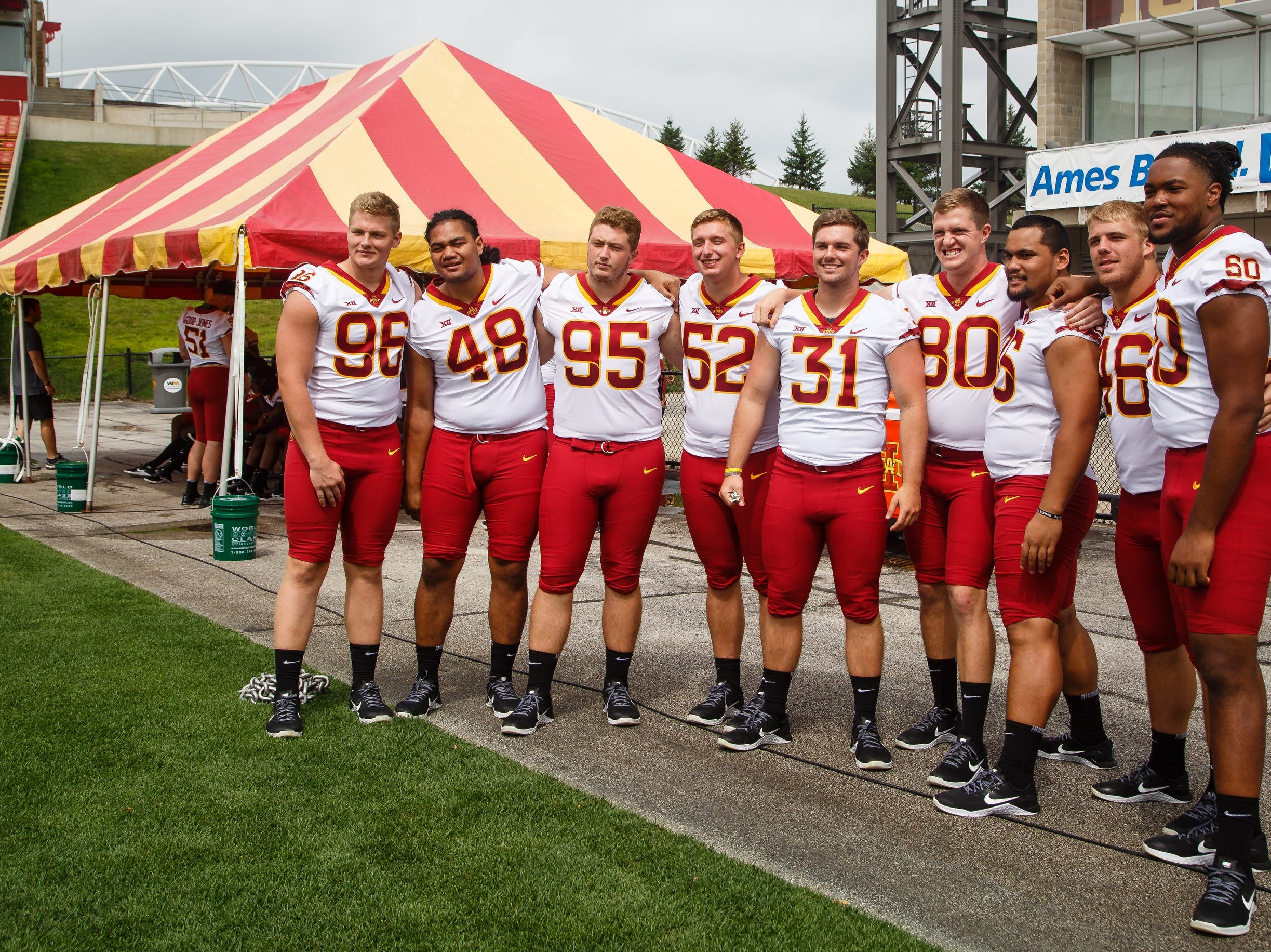 Members of the Iowa State defense pose for a photo during football media day on Tuesday, Aug. 7, 2018 in Ames.