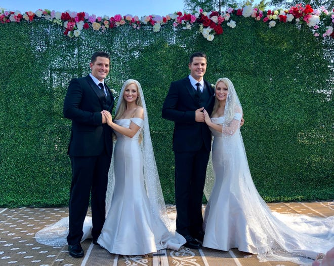 Jeremy Salyer and Briana Deane, left, and Joshua Salyer and Brittany Deane, right, are two sets of identical twins who married in a double wedding at the annual Twins Days Festival in Twinsburg, Ohio on Saturday, Aug. 4, 2018.