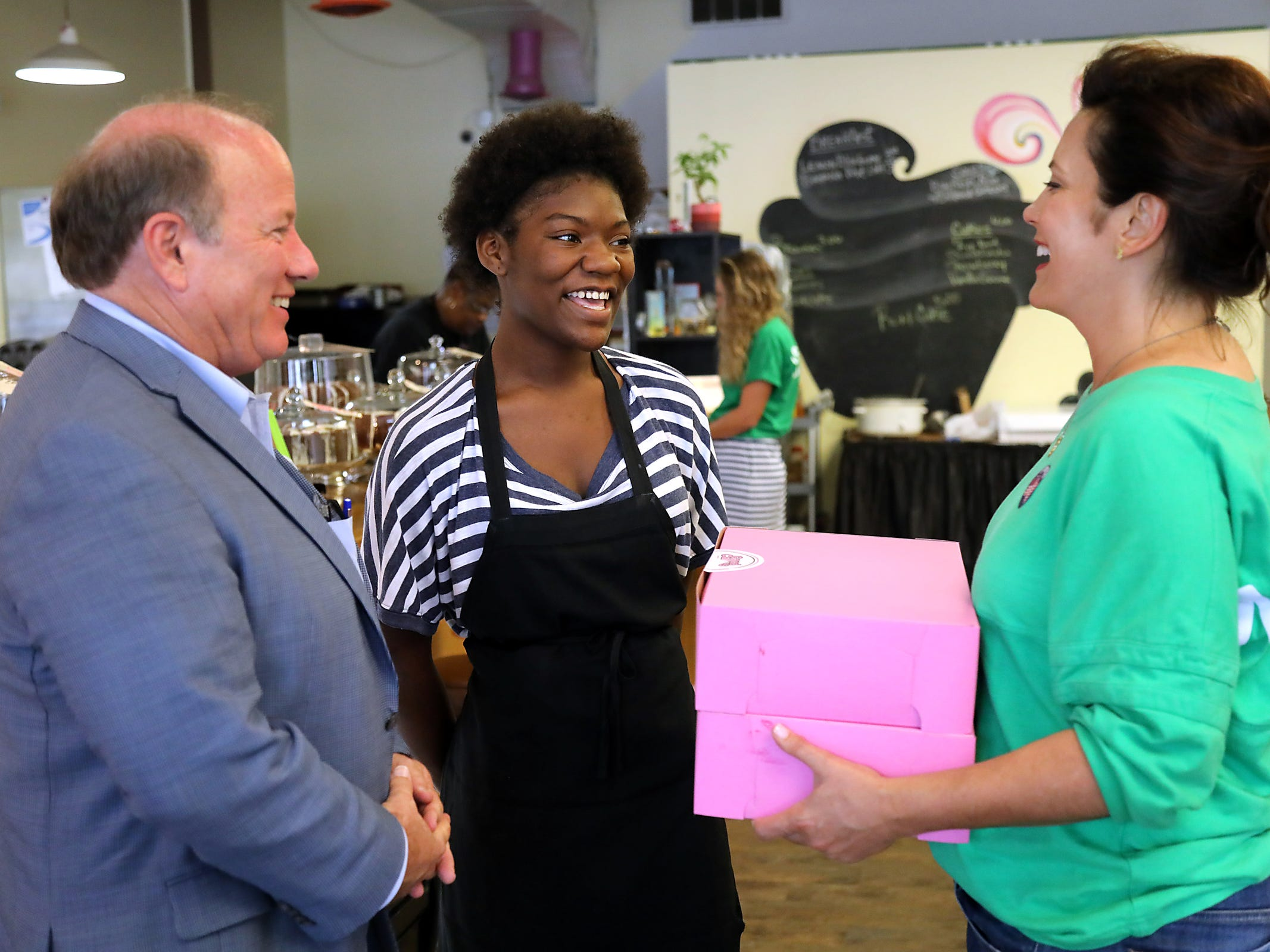 Gubernatorial Democratic Candidate Gretchen Whitmer talks with Chantrice Jones, 15, of Detroit with Detroit Mayor Mike Duggan about her internship at Good Cakes and Bakes through the Grow Detroit's Young Talent summer job program while talking to voters on Michigan Primary day on Tuesday, Aug. 7, 2018.