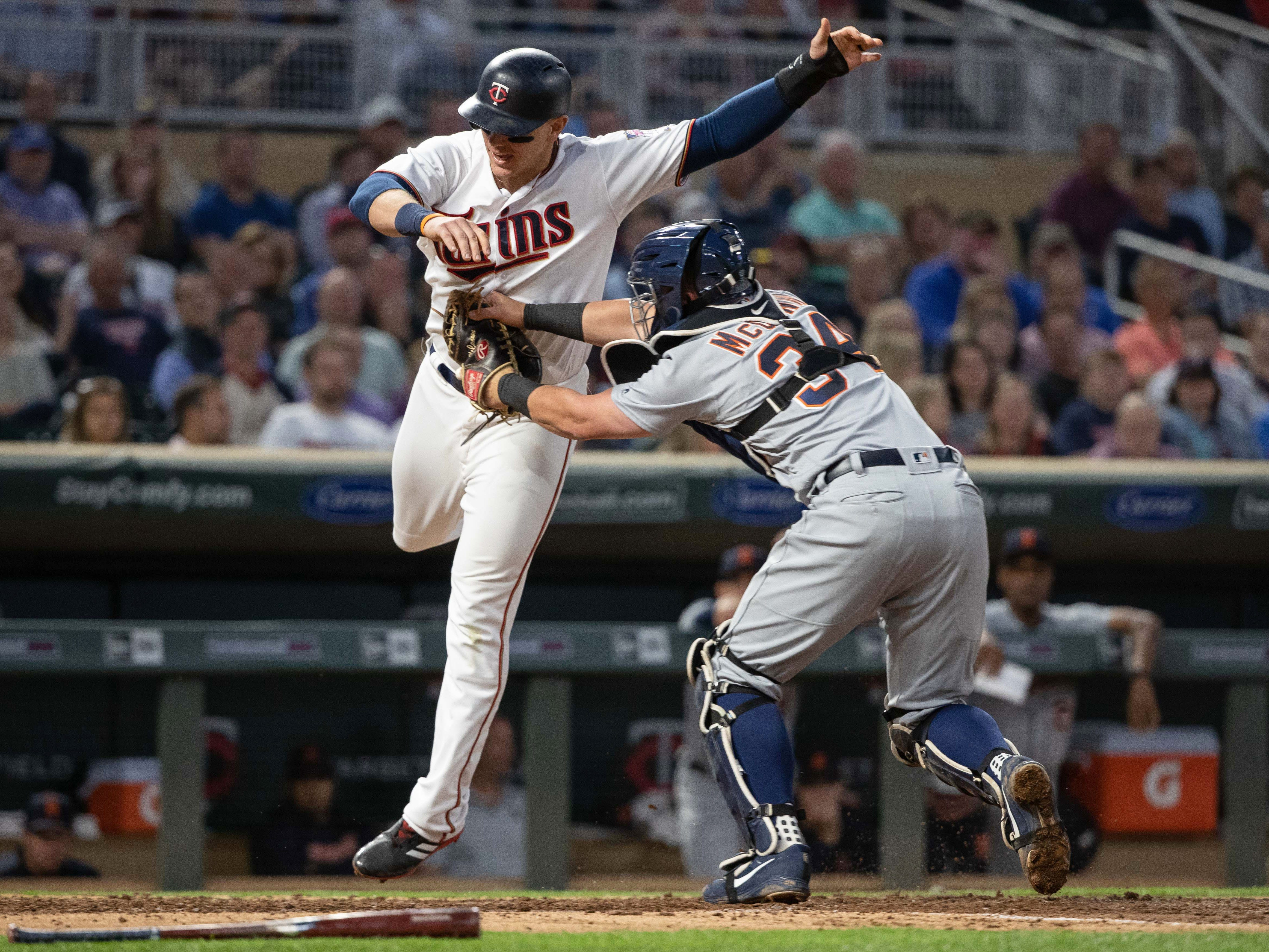May 22 in Minneapolis: Twins 6, Tigers 0. Catcher James McCann tags out first baseman Logan Morrison at home plate during the fifth inning at Target Field.