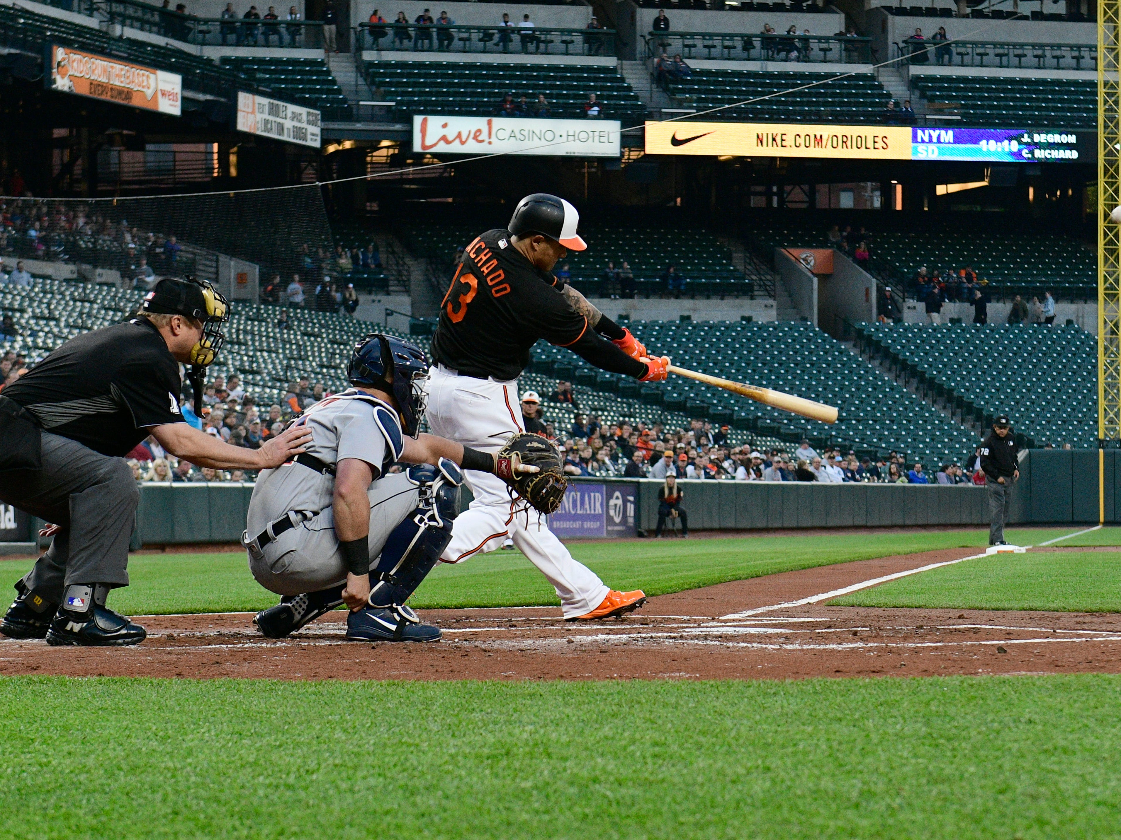 April 27 in Baltimore: Orioles 6, Tigers 0.  Shortstop Manny Machado hits a solo home run off Mike Fiers during the first inning at Oriole Park at Camden Yards.
